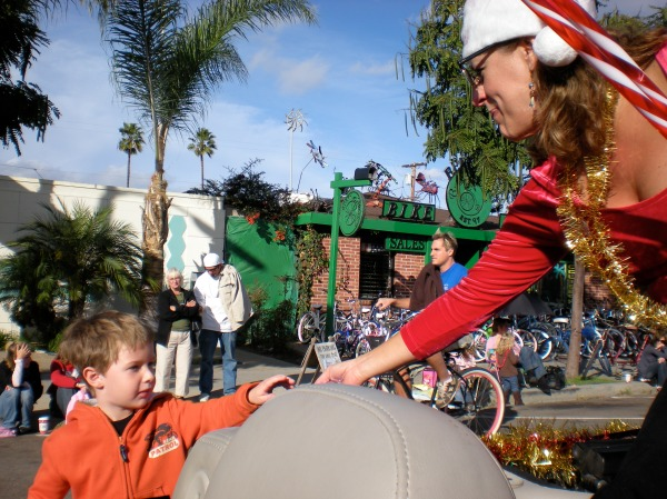 Sally sharing sweets at the PB Holiday Parade