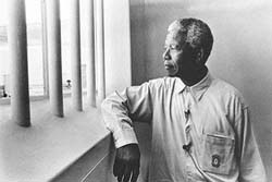 Nelson Mandela looking out from Prison.